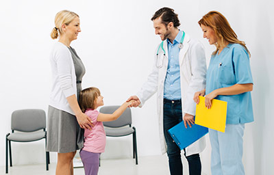 ___stock-photo-56013298-mother-with-daughter-at-doctors-office